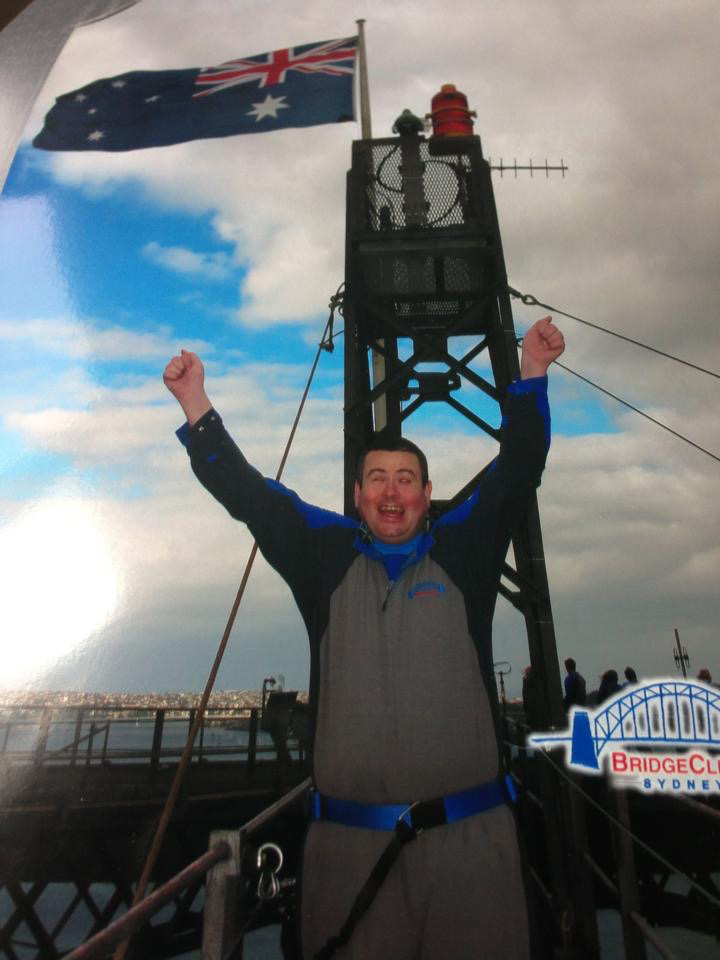 Photo of Martin Rigby on top of Sydney Harbour Bridge.