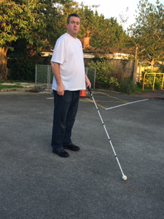 Image of Martin walking with cane
